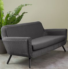 Johan outdoor rattan sofa, MADE.COM Read a book outside during the day and relax in the sunshine, or entertain guests comfortably and stylishly. It's designed to endure the weather - just take the cushions inside during heavy rain.