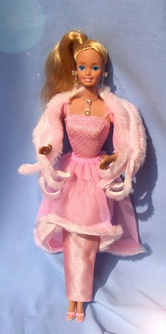Pink & Pretty Barbie was my absolute favorite.  My first one had a terrible accident (Got ran over by the family car and then chewed on by the dog), so my mom got me a second one.  Forever after they were TWINS, one disfigured and in the hospital of course..