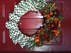 I made this fall wreath with chevron printed burlap wired onto a grapevine base. Then hot glued the floral on! Turned out great!