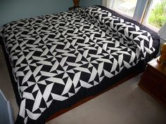 Flying Martins quilt - made of black and ivory triangles.