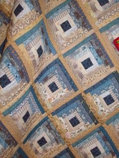 I love, love, love this! I cannot say enough times that the log cabin is my favorite pattern. And these colors are gorgeous! log cabin quilt in blues and browns More