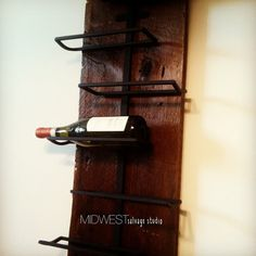 Salvaged barn wood combined with a welded steel wine rack create an urban rustic look that is both functional and beautiful. Each piece is made to order - no two are exactly alike! Our 7 bottle wine rack measures 3 1/2ft long X 12in wide.