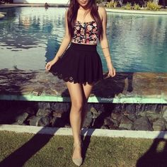 Pretty outfit. Floral cropped top, high-rise skirt with cut-out detail and flats.