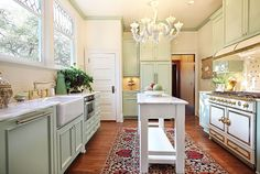 Farmhouse inspired kitchen designed with the modern chef in mind. #oven #sink #mint