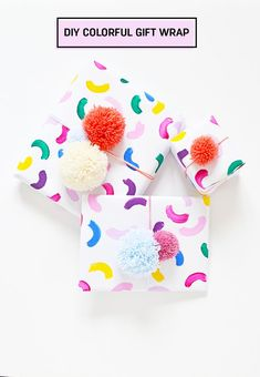 Don't like store bought gift wrappers? Learn how to make this easy colorful gift wrap in 10 minutes and top it off with a couple of pom poms