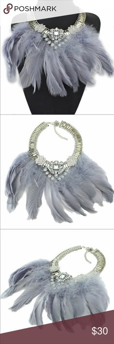 FEATHER AND CRYSTAL NECKLACE NIP This is such a fun, statement piece. Pale gray feathers adorn a silver-tone and crystal choker.   Lobster claw closure. New in packaging. Jewelry Necklaces