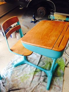 Spray painted turquoise vintage school desk.