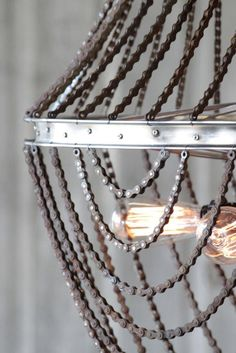 Seriously, how cool is this?  Bicycle Wheel and Bicycle Chain Chandelier