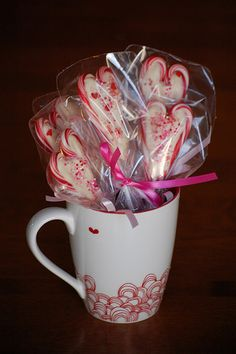 Lollipops made from candy canes and candy melts. Easy kids craft!