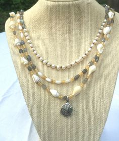 A personal favorite from my Etsy shop https://www.etsy.com/listing/280598508/sea-shell-necklace-beach-necklace-with