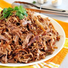 Super easy slow cooker Pork Carnitas, the secret to PERFECT brown bits while keep it the pulled pork SO JUICY!!