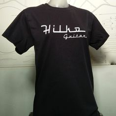 "Look fabulous on any occasion and get your ""Hilko T-Shirt"" here!Features- Color: Black, White Logo- 100% heavy cotton preshrunk - Double-needle stitch - Taped neck and shoulders for durability - Full front screen printMen Size Available:SmallMediumLargeXLXXL"