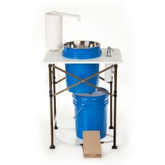 Wash your hands in style. This portable sink can be used in any location and has a built-in soap dispenser and paper towel holder. This is foot-operated with no handles to turn.