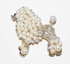 Kenneth Jay Lane Brooch - White Poodle Pin This is an adorable poodle brooch by Kenneth Jay Lane and is done in gold tone metal, clear crystals and faux pearls. I think it is so cute. If you love dogs, youll love this pin! The pin is 2-1/2 tall and 2-1/2 wide. It has all of its stones and pearls and is in Like New Condition. It is perfect for work, church or any special occasion. It would also make a great gift for someone. Dont miss the chance to get this adorable designer brooch today. Buy…