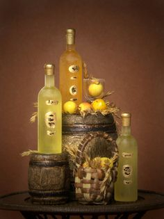 This enchanting handmade miniature wine set is a decorative eyecatcher for every dollhouse or miniature wine cellar.    The set contains:  - 1 big