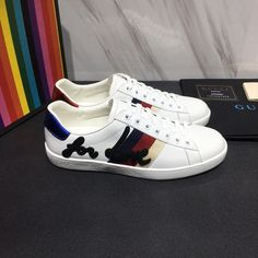 d92abe1a9aa Mens white Ace embroidered sneaker Gucci Sneakers