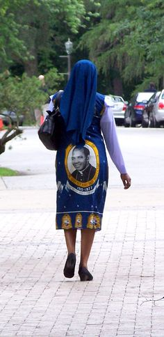 A nun wearing a garment featuring Bishop Godfrey Mary Paul Okoye CSSP. He founded an order of nuns in West Africa.