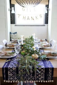 thanksgiving tablescapes navy and white pom pom table setting