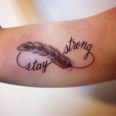 21981 tender stay strong quote with feather infinity tattoo on arm