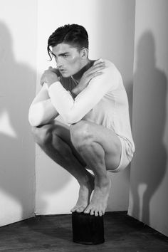 Taylor Gannon photographed by Corey Goodyear. This male pose is perfect reference for many things. At first I saw a satyr standing on his hooves crouched and mystical, but then I saw a gargoyle perched atop a roof. So many good ideas in this one.
