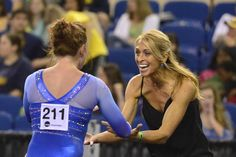UF coach Rhonda Faehn congratulates Bridget Sloan after a routine in last Friday's NCAA Championships semifinals at Fort Worth, Texas.