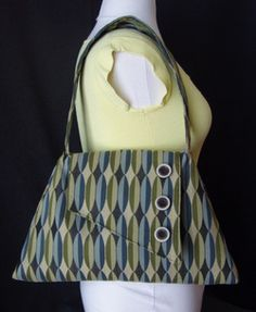 Roomy purse, with plenty of interior pockets and key chain tab. Decorative Wooden Buttons on exterior