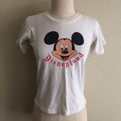 "Vintage 60s Mickey Mouse Disneyland T Shirt Top This is an original true vintage Disneyland Mickey Mouse t shirt from the late 1960's. Excellent condition no stains. One pin dot hole on the upper shoulder shown in photos. 100% cotton. Measurements are taken laying flat and are 17"" armpit to armpit and 19"" long top of shoulder to end Vintage Tops Tees - Short Sleeve"
