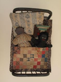 Very Unusual 19thc. Folk Art Doll Bed with Early Primitive Accessories.
