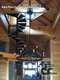 Wow Barn Pros customized Belmont barn with spiral staircase leading to loft