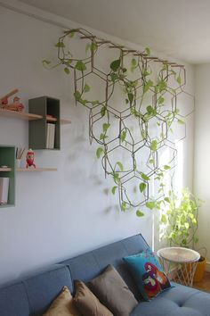 Anno is a wall grille that consists of several metal rings . - Home accessories - Anno is a wall grille consisting of several metal rings. Plants Anno is a wall grille consisting of - Wall Trellis, Plant Trellis, House Plants Decor, Plant Wall Decor, Hanging Plants, Plants Indoor, Indoor Plant Wall, Potted Plants, Indoor Plant Lights