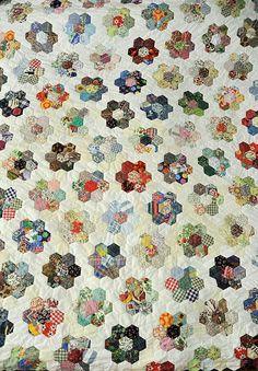 Grandmother's Flower garden quilt by bearpawandbearpaw, via Flickr