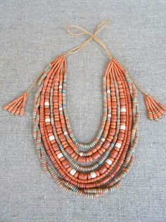 Coral color statement necklace for a summer outfit.
