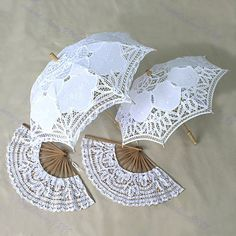 white lace parasols or fans for bridesmaids instead of bouquets
