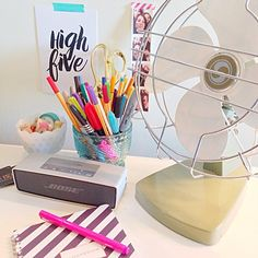 My happy colorful work space with a vintage fan and lots of color. #vintage #styling #desk