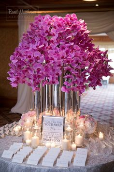 Wedding seat cards highlighted with gorgeous orchid arrangement!
