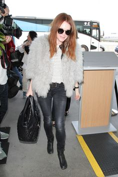 Julianne Moore takes airport style to a new level in her gray-scale look.   - HarpersBAZAAR.com