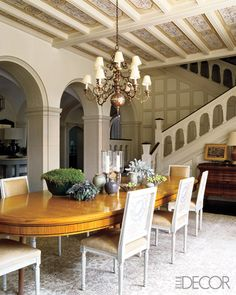 Dining room in a Tudor home renovated by S.R. Gambrel. Elle Decor. Dining Table & Chairs