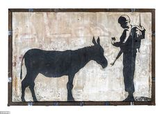 West Bank: Donkey Document was painted on the separation wall in the Israeli-occupied West Bank in 2007 but was sold at auction in California