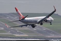 Gol Linhas Aereas Inteligentes Boeing 737-8EH banking left to land on runway 02R. Outstanding Photo!!  Photographer Marcelo F. De Biasi