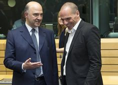 European Economic and Monetary Affairs Commissioner Pierre Moscovici (L) talks with Greek Finance Minister Yanis Varoufakis (R) during a Eurozone finance ministers emergency meeting on the situation in Greece in Brussels, Belgium June 25, 2015. Greece's international creditors gave Athens an ultimatum to come up with a credible reform plan on Thursday.
