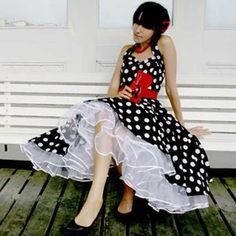 Black embroidered polka-dot sundress.