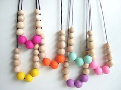 Silicone teething necklace geometric graduated wooden bead long style. Soft BPA free for mums & bubs. Choose a colour by ElleOneNine on Etsy https://www.etsy.com/listing/205851883/silicone-teething-necklace-geometric