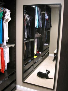 a walk-in closet that uses the Ikea PAX wardrobe closet system in black Ikea Closet Doors, Ikea Closet System, Walk In Closet Ikea, Bedroom Closet Storage, Master Closet, Closet Mirror, Bedroom Wardrobe, Wardrobe Closet, Master Bedroom