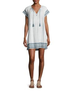 "Soft Joie ""Megdalyn"" tie-dye dress with embroidered edges. Split V neckline with tassel ties. Short sleeves. Shift silhouette. Even hem; side slits. Pullover style. Cotton. Imported."