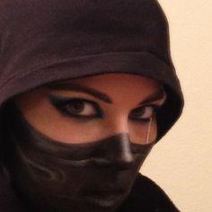 Painted ninja mask with cat eye and scar #ninja #ninjamakeup #facepainting