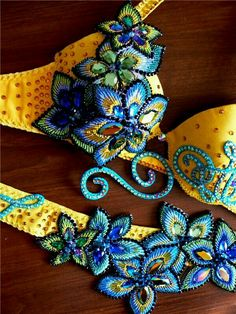 Love these blue flowers paired with the yellow Belly Dance Outfit, Tribal Belly Dance, Lyrical Costumes, Belly Dance Costumes, Tribal Fusion, Dance Oriental, Decorated Bras, Yellow Costume, Beautiful Costumes