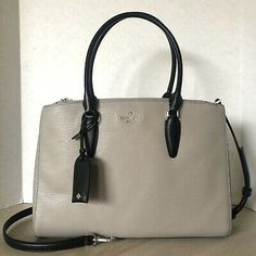 Two tone in Soft Taupe and Black. Interior zipper pocket and two slip pockets. Black Crossbody, Wristlet Wallet, Taupe, Jackson, Satchel, Kate Spade, Medium, Silver, Leather