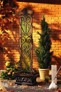 Green tempered glass surface with antique copper frame provide a natural contrast in this elegant, six foot tall waterfall fountain. For indoor and outdoor use. The Water Trellis creates a captivating