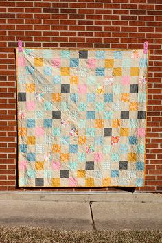 """Patchwork Picnic Quilt Tutorial - In Color Order by Jeni Baker- 68""""x72"""", a great size for a summer nap or picnic.  I quilted it with simple diagonal lines using Aurifil thread in beige, and bound it in a print from Little Folks by Anna Maria Horner. Sewing Level: Beginner Friendly *For this quilt you'll need a total of 120 print 5"""" squares and 120 background 5"""" squares. You could use more or less fabrics for desired variety!"""