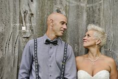 Wedding photo of bride and groom in front of a rustic barn